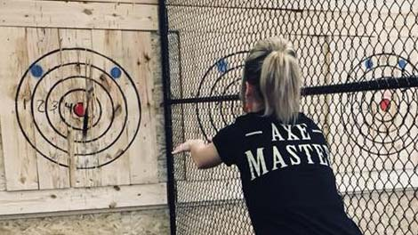 Female axe master throwing