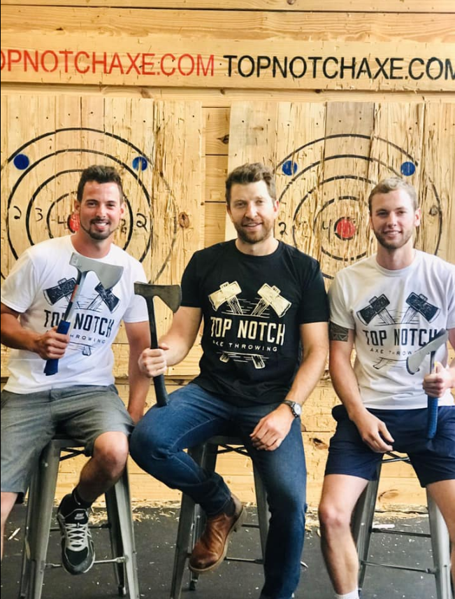 Pictured: Joe Prinster, Brett Eldredge and Steven Prinster at Top Notch Axe Throwing.